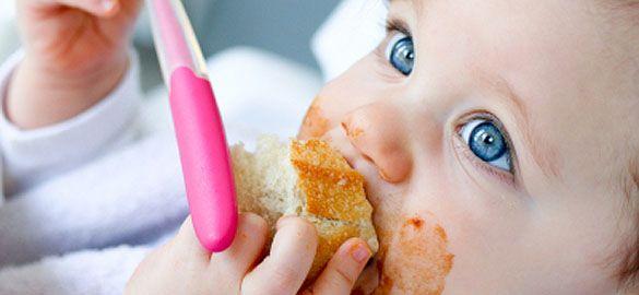 fac baby eating fruit