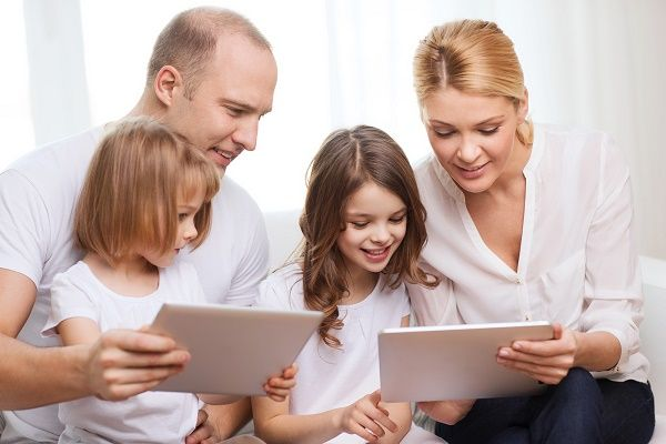 family, children, technology, money and home concept - smiling f