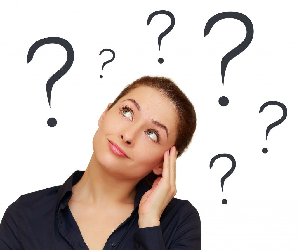 Thinking woman with question marks above the head isolated