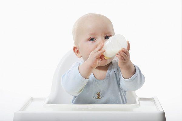 Baby boy (6-11 Months) drinking milk from milk bottle